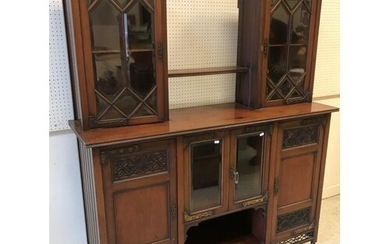 An Edwardian mahogany and blind fretwork decorated side cabi...