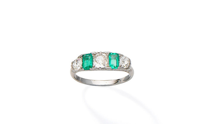 An emerald and diamond five-stone ring