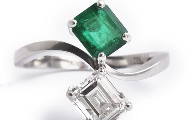 An emerald and diamond ring set with an emerald-cut emerald and a rectangular baguette-cut diamond weighing app. 1.00 ct., mounted in 18k white gold. H/VVS.