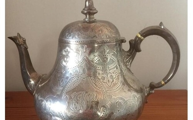Antique Victorian silver teapot, having scroll handle and hi...