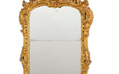 Carved openwork and gilded wood mirror with an...