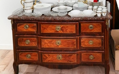 Chest of drawers with a central rosewood veneer...
