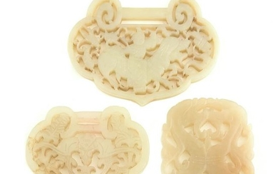 Collection of Three Carved Celadon Jade Pendants.
