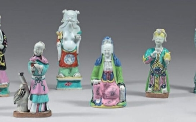 Eight Chinese porcelain statuettes. Jiaging. Decorated with the enamels of the Rose Family, representing: a woman with a crane, two figures with yellow headdresses, a guanyin, three immortals, a young man dressed in a pale blue dress, small lacks...