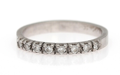 SOLD. Eliise Maar: A diamond eternity ring set with eight brilliant-cut diamonds weighing a total...