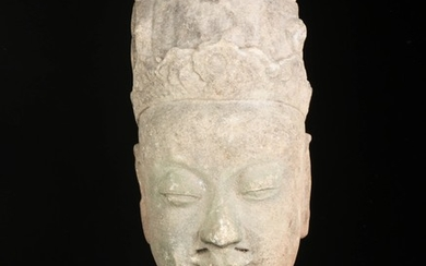 Chinese head in stone, presumably. Ming