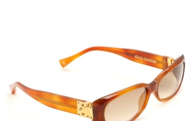 SOLD. Louis Vuitton: A pair of brown acetate sunglasses with golden hardware. Original case. –...