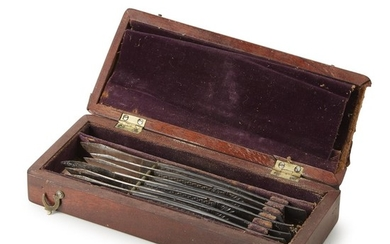 Mahogany box with six surgical scalpels W. & H....
