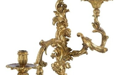 Pair of finely chiselled and gilded bronze sconces.