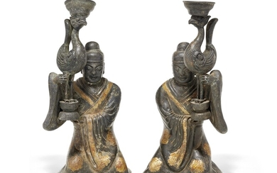 Pair of partially gilt silver kneeling figures China, early 20th Century