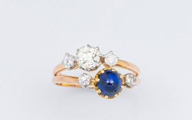 """Ring """" Toi et Moi """" in 750°/°° yellow gold composed of two rings set with an antique cut diamond shouldered by two small diamonds for one, and a blue stone cabochon of imitation blue stone shouldered by two small antique cut diamonds in platinum..."""