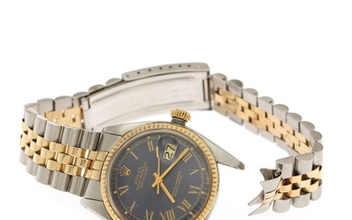 Rolex: A gentleman's wristwatch of 18k gold and steel. Model Datejust, ref. 1601. Mechanical movement with automatic winding, cal. 1570. 1977.