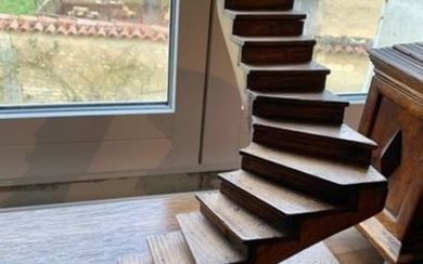 Sharply angled oak staircase, fixed on a large...