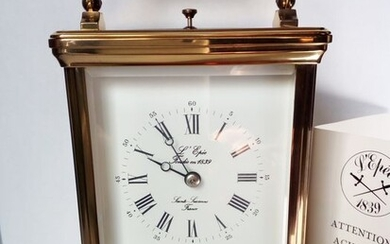 The Epee table clock - Brass, brass and crystal - Late 20th century