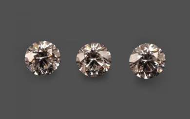 Three Loose Round Brilliant Cut Diamonds, weighing 0.55, 0.59 and...
