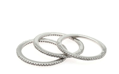 NOT SOLD. Three diamond eternity ring each set with numerous brilliant-cut diamonds, mounted in 14k...