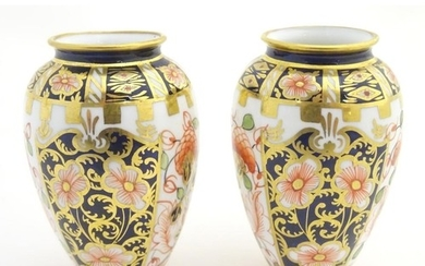 Two small Crown Derby Imari vases, with floral decoration an...