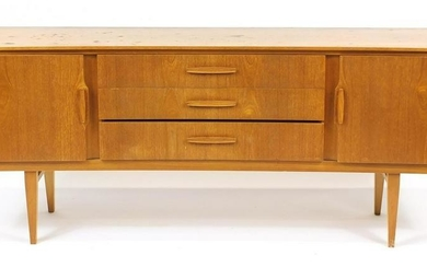 Vintage Beautility teak concave sideboard with two