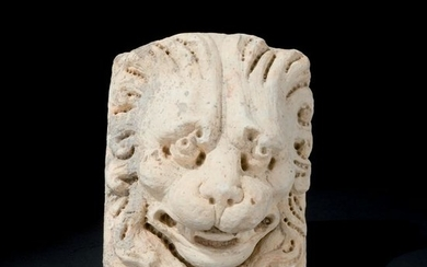 A 17th century marble high relief of a lion's head