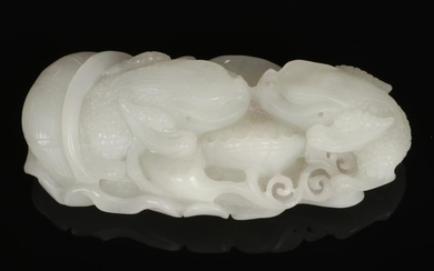 A 19th century Chinese pale celadon jade carving. Formed as ...