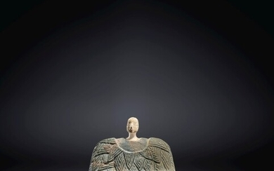 A BACTRIAN CHLORITE AND LIMESTONE SEATED FEMALE FIGURE, CIRCA LATE 3RD-EARLY 2ND MILLENNIUM B.C.
