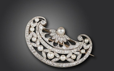 A Belle Epoque pearl and diamond brooch, the stylised fan is pierced and set with diamond and pearl laurels in platinum and gold, 4cm wide, detachable brooch fitting to reverse, fitted case