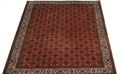 A Bidjar carpet, Persia. All over herati design on a red field. Good quality. Late 20th century. 306×211 cm.