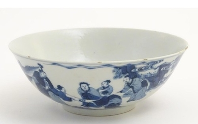 A Chinese blue and white bowl depicting figures in a landsca...