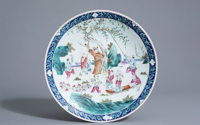 A Chinese famille rose charger with playing boys...