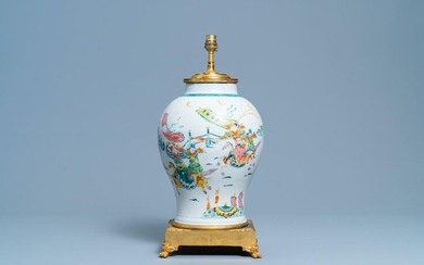 A Chinese gilt bronze lamp mounted famille rose 'warrior' vase, 19/20th C.