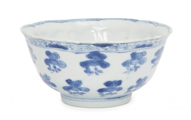 A Chinese porcelain moulded bowl, Kangxi period, painted in underglaze...