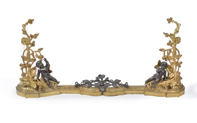 A French gilt and patinated metal adjustable fender in Rococo taste