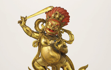 A GILT-BRONZE FIGURE OF DHARMAPALA AND A STAND, QIANLONG CAST SEVEN-CHARACTER MARK AND OF THE PERIOD (1736-1795)