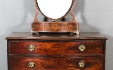 A George III Mahogany Serpentine Fronted Chest, with moulded...