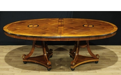 A George III style oval dining table, by repute purchased fr...