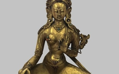 A Gilt Bronze Figure of Green Tara, Tibet, 17 - 18th Century.