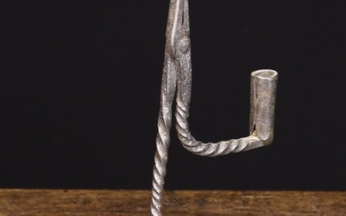 A Good 18th Century Wrought Iron Rush Nip with Candle-socket. The wrythen stem driven into a deep be