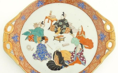 A Japanese twin handled plate with hand painted