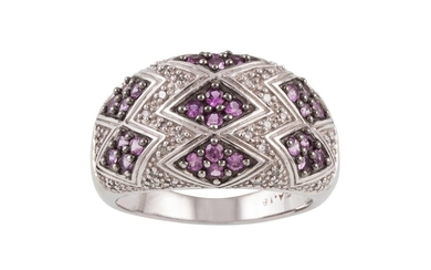 A PINK SAPPHIRE AND DIAMOND DRESS RING, pavé set in white go...