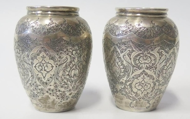 A Pair of Persian Silver Vases with chased foliate decoratio...
