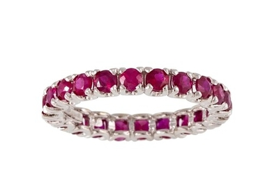 A RUBY FULL BANDED ETERNITY RING, the circular stones mounte...