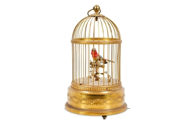 A SMALL EARLY 20TH CENTURY FRENCH GILT METAL SINGING BIRD IN CAGE AUTOMATON