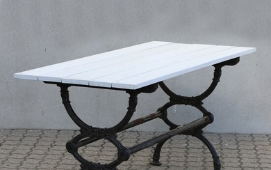 A Swedish garden table with cast iron lower part and painted top. 20th century. H....