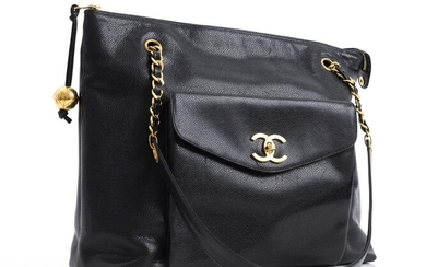 A VINTAGE TOTE BAG BY CHANEL-Styled in black Caviar leather with gold metal hardware, 30 x 36 x 11cm.