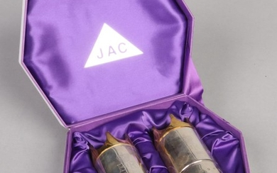 A boxed pair of limited edition silver and silver gilt peppe...