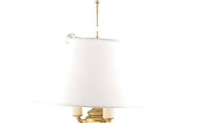 A brass boulette table lamp with telescopic adjustable shade.