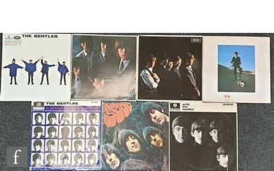 A collection of The Beatles, The Rolling Stones and Pink Flo...