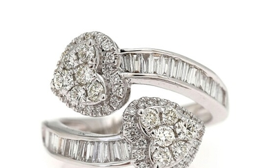 A diamond ring set with numerous brillant and baguette-cut diamonds weighing a total of app....