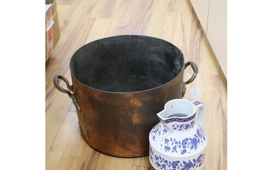A large copper two handled preserve pot and a large modern b...