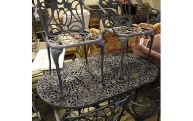 A modern aluminium garden table and four elbow chairs, 140 x...